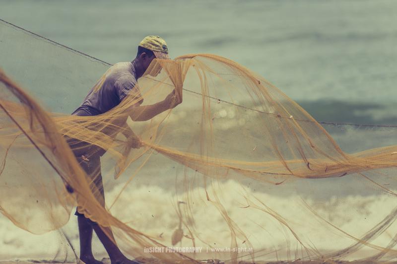 Fisherman sorting a fishnet